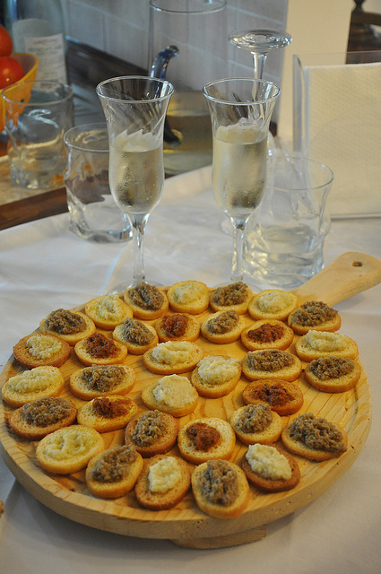 Prosecco and crostini from cook in venice